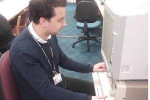 Person using a microfilm reader